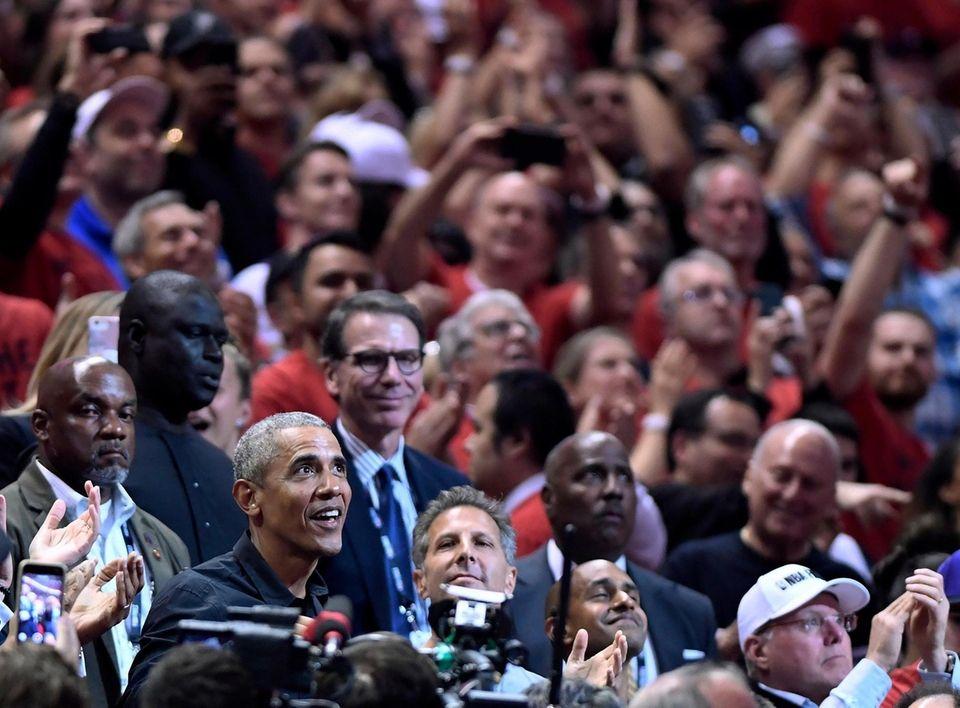 Former President Barack Obama looks up during the