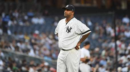 Yankees starting pitcher CC Sabathia reacts after he
