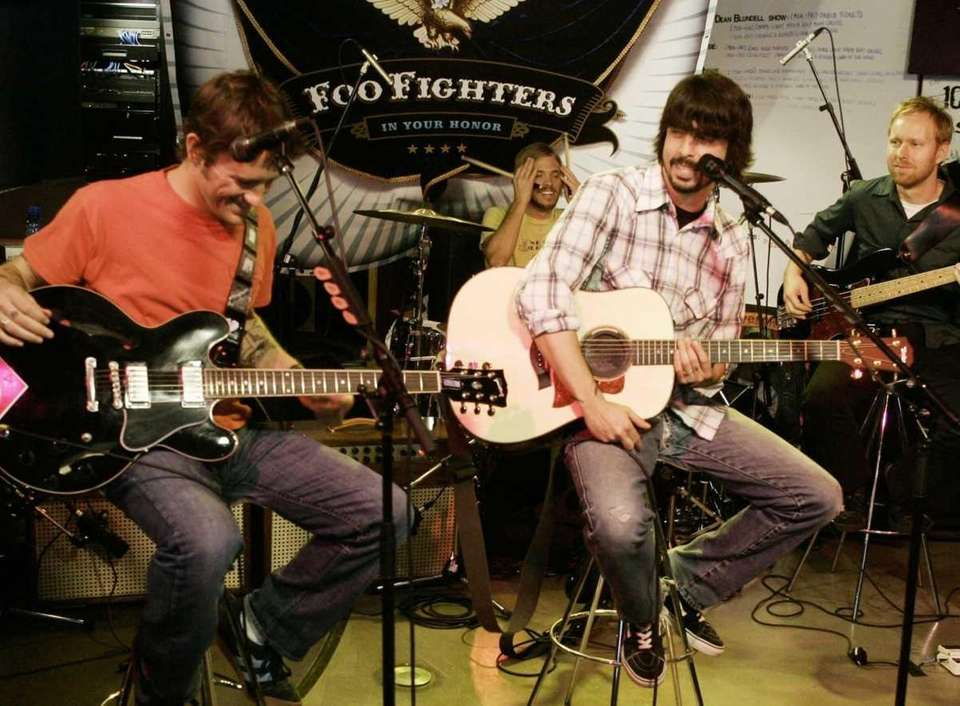 The Foo Fighters laugh while performing at 102.1
