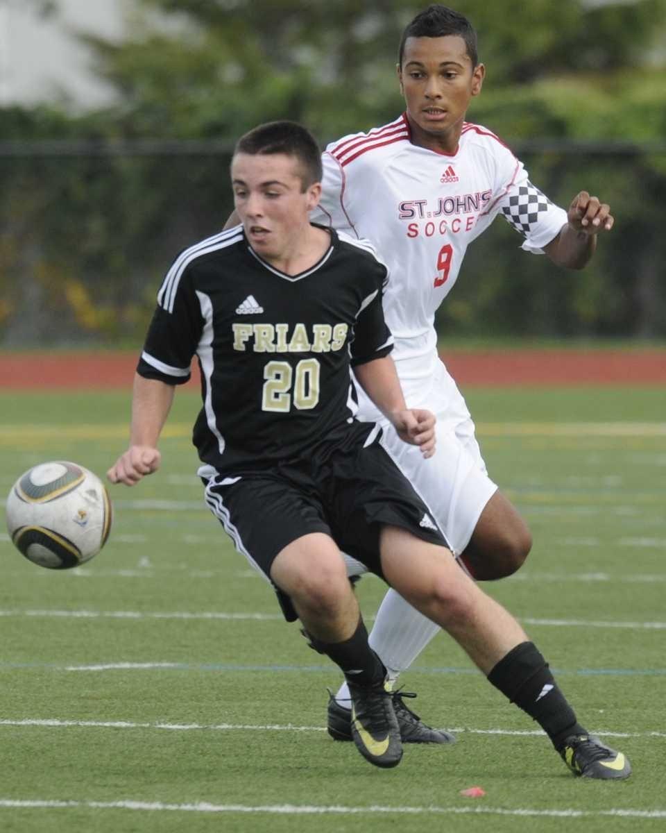 (L) St Anthony's #20 Brendan Riordan drives the