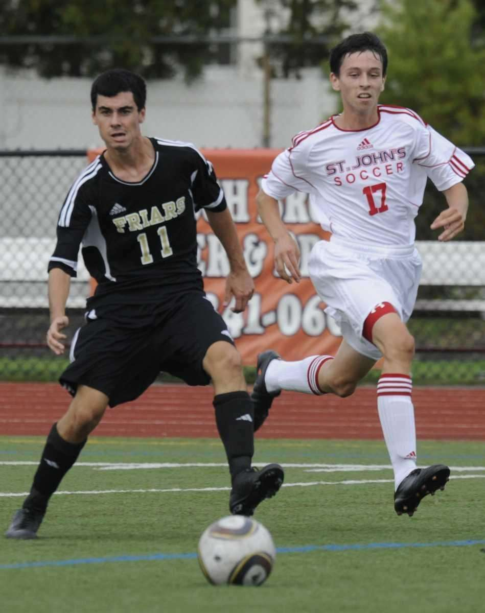 (L) St Anthony's #11 Colin Volpe drives the