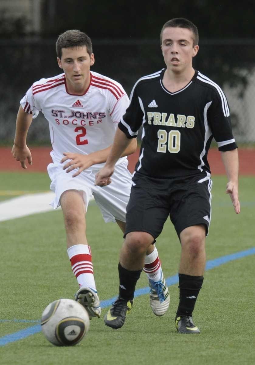 (R) St Anthony's #20 Brendan Riordan drives the