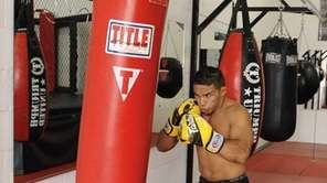 Dennis Bermudez works the bag while training at