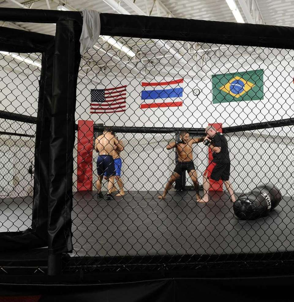 Dennis Bermudez (center), a mixed martial artist from