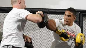 Dennis Bermudez, right, trains with Ryan LaFlare at