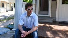 Jonathan Borriello, 29, outside his Northport home on