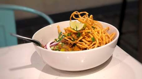Khao soi, noodles in Thai yellow curry topped
