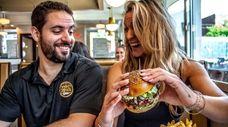 John and Alyson Kanaras enjoy a burger at