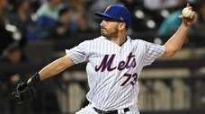 New York Mets relief pitcher Daniel Zamora delivers