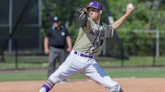 Eric Foster #17 of Sayville delivers the pitch