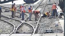LIRR workers repair tracks near Speonk on May