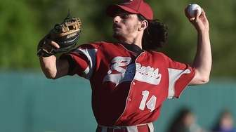 Chris Lydon #14, Clarke pitcher, delivers to the