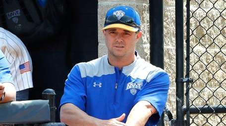 NYIT head coach Frank Catalanotto gives signals from