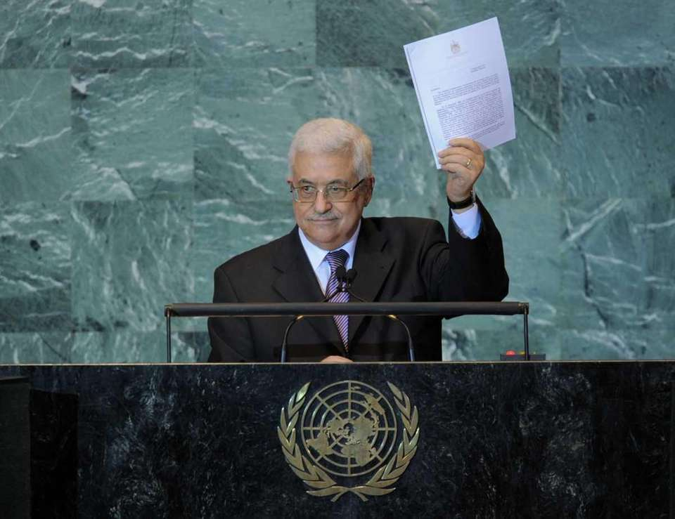 Mahmoud Abbas, President of the Palestinian Authority, holds