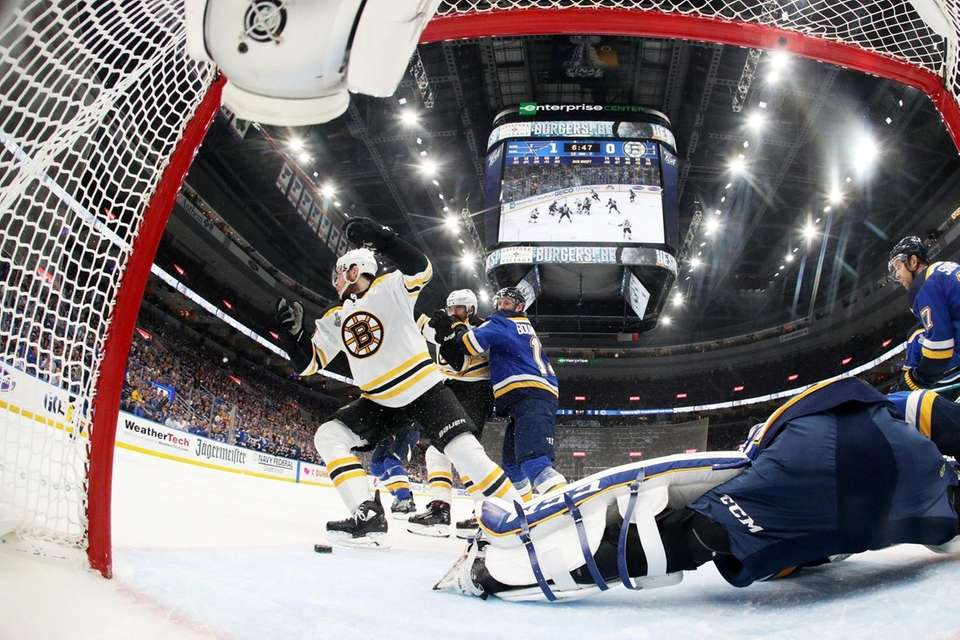 Charlie Coyle #13 of the Boston Bruins scores