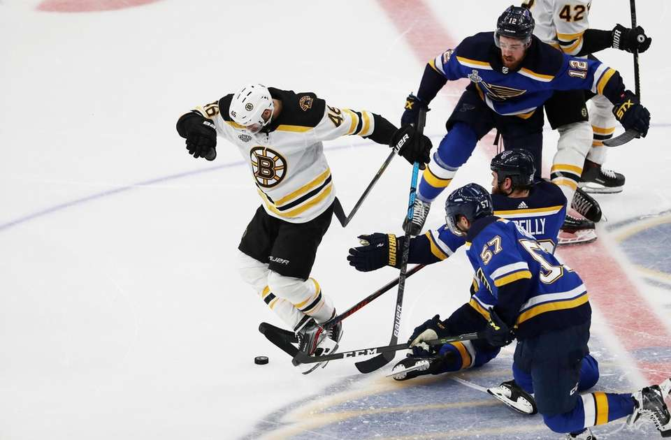 David Krejci #46 of the Boston Bruins battles