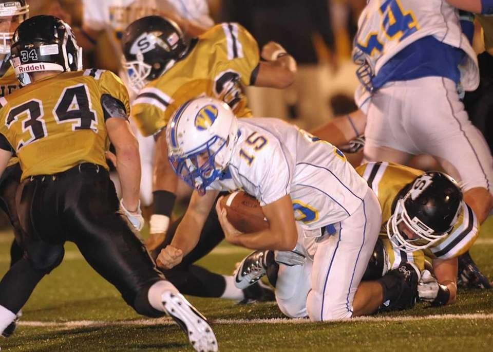 West Islip's Anthony Santo(15) runs for a couple