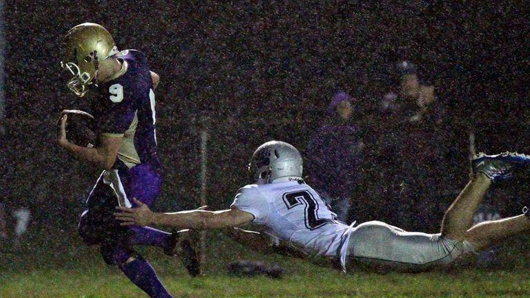 Greenport quarterback Ryan Malone #9 scrambles into the