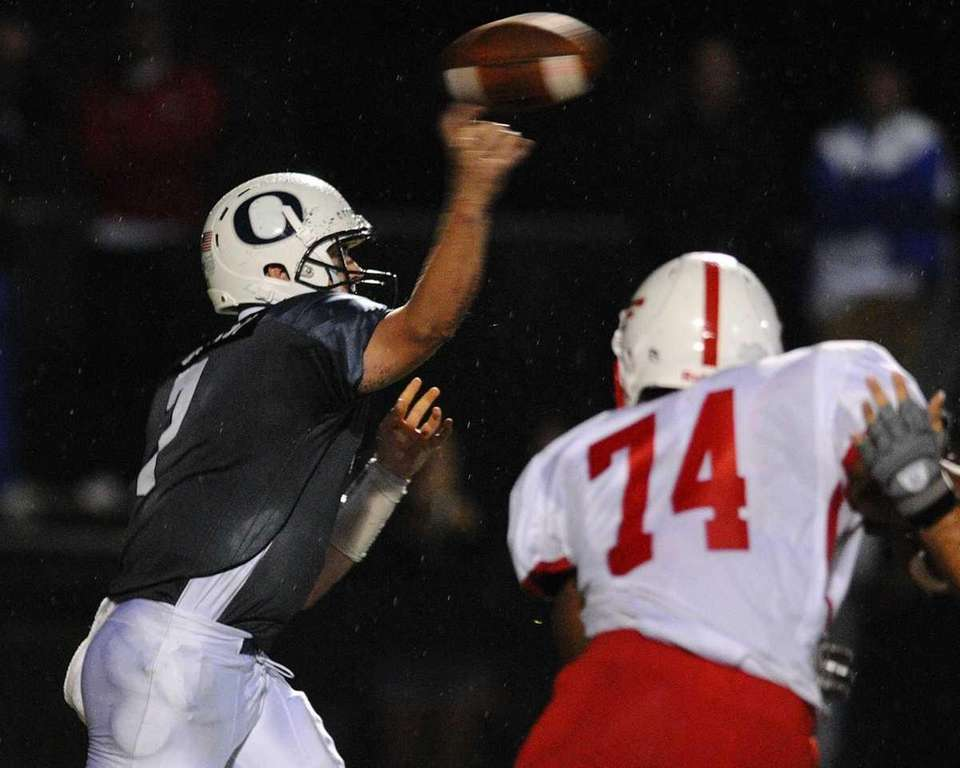 Oceanside High School quarterback #7 John Grassi throws