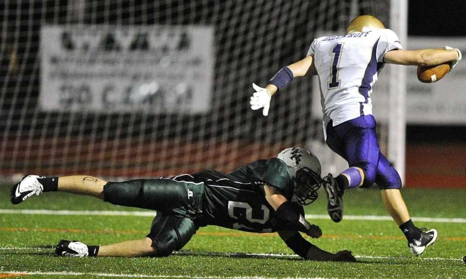 Sayville's Tom Dieckhoff evades a takedown by Westhampton's