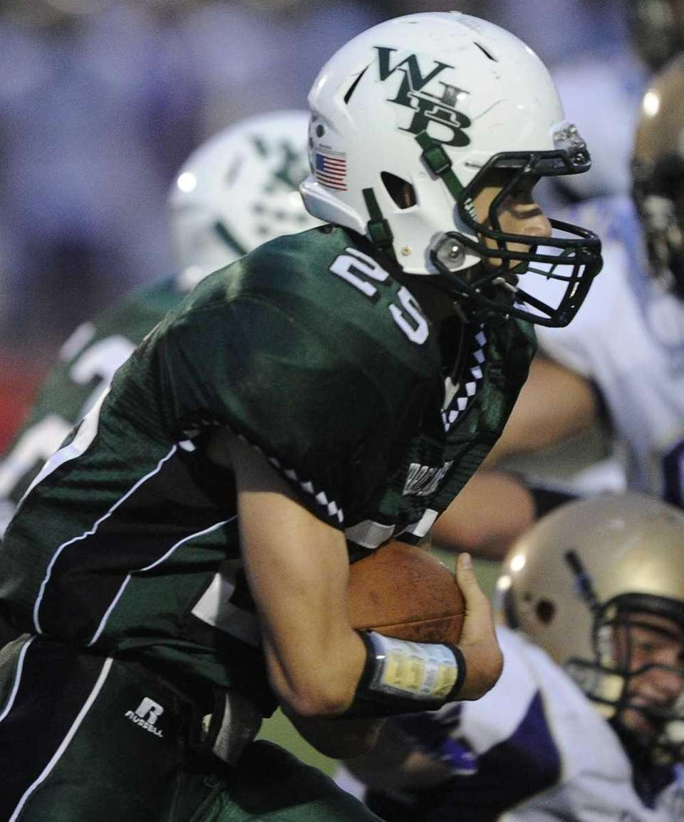 Brendan Eckart carries for Westhampton in the Suffolk