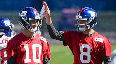 Giants quarterback Eli Manning looks on as wide
