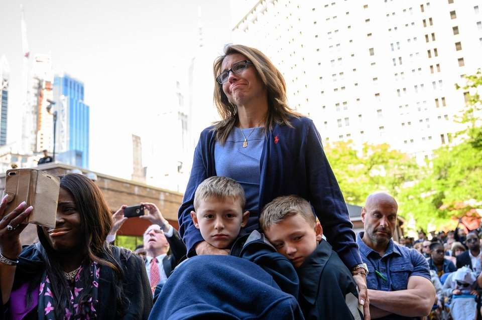 Lisa Tuozzolo with her sons, Austin, left, and