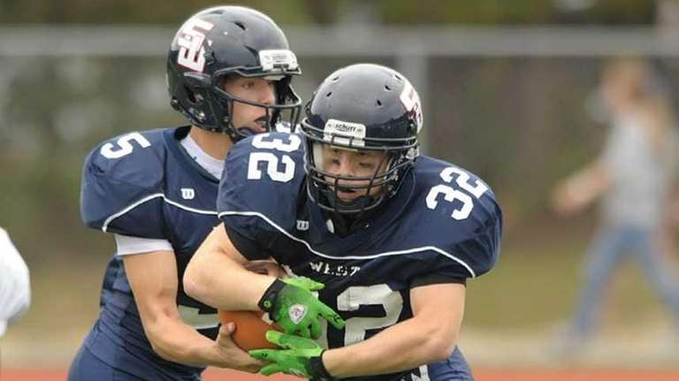 Smithtown's James Pannell (32) takes the handoff from