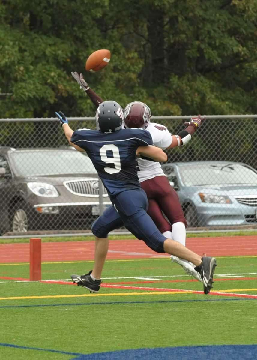 Joe Gimeli (4) breaks up the pass to
