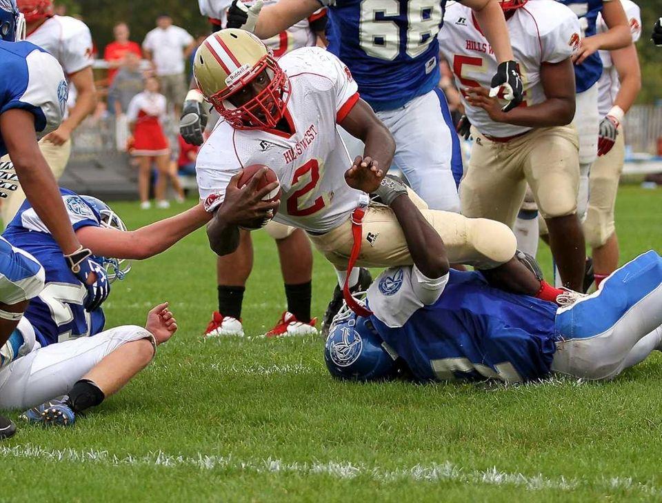 Hills West quarterback Devante McFarlene #2 goes over