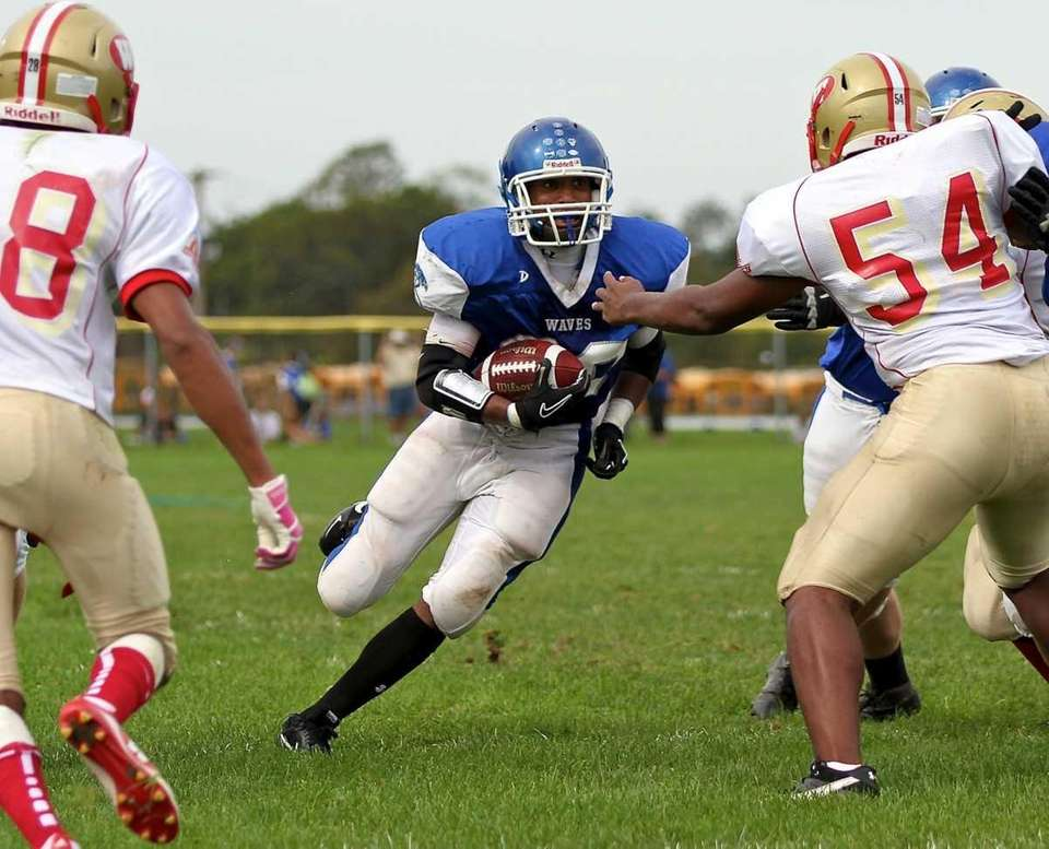 Riverhead running back Jerimiah Cheatom #20 finds the