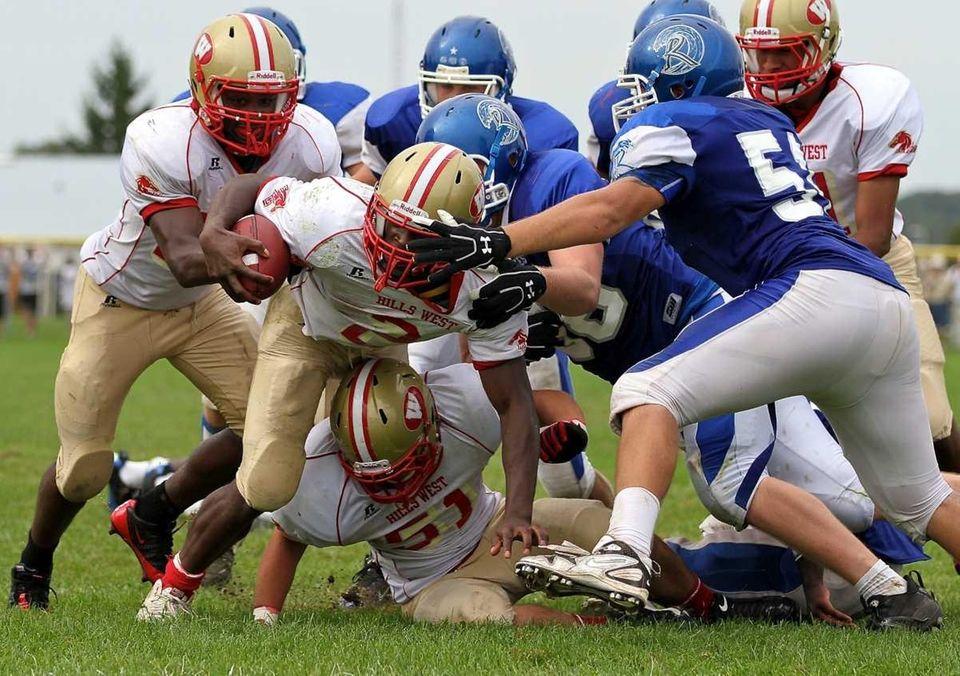 Hills West quarterback Devante McFarlene #2 is swarmed