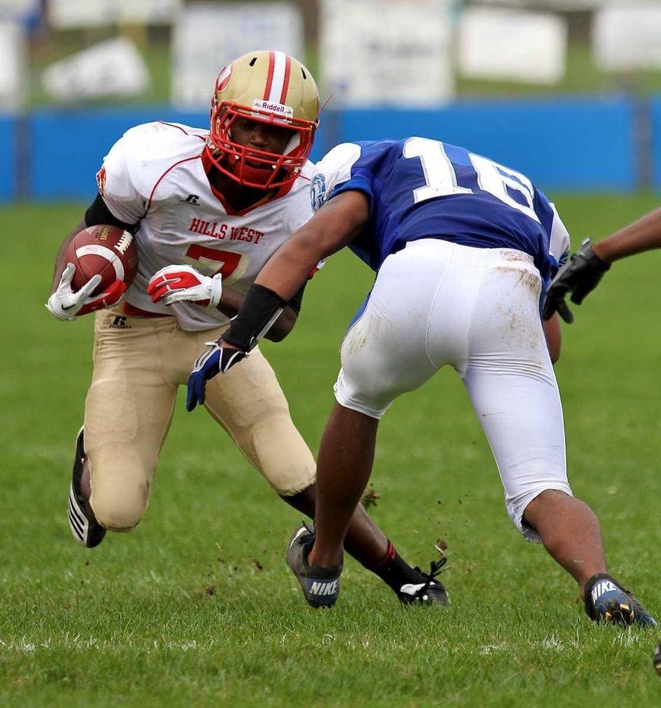 Hills West receiver Jassean Banks #7 goes up