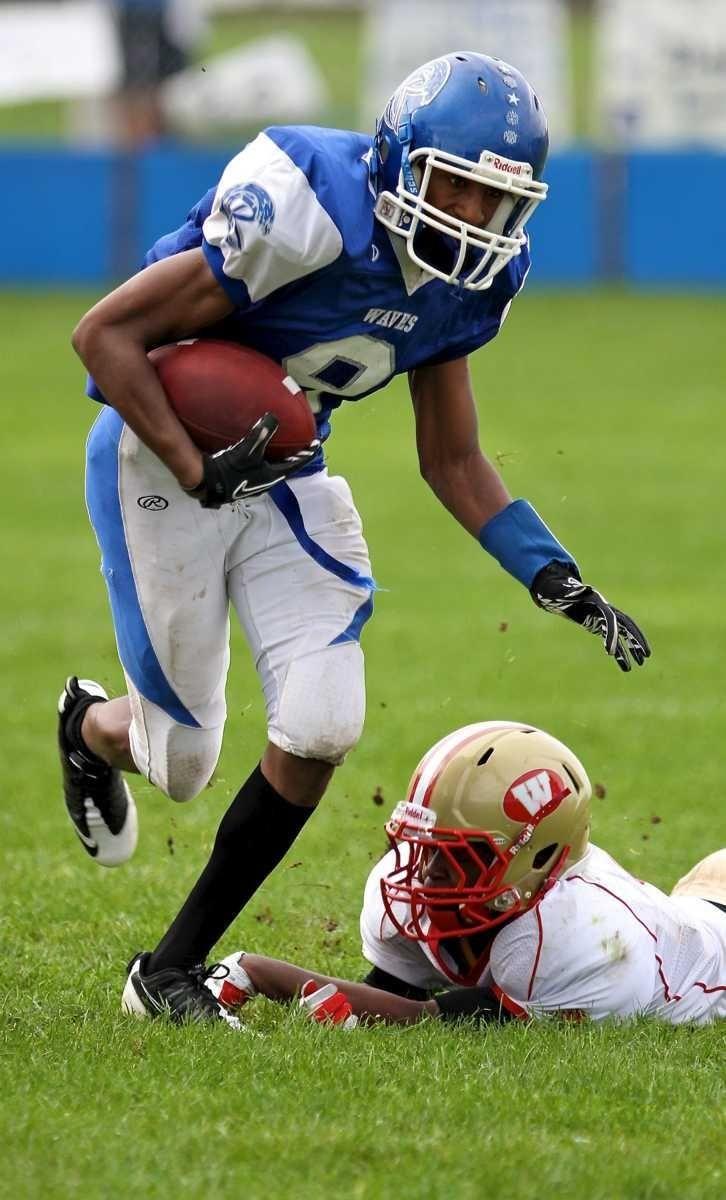 Riverhead receiver Quinn Funn #8 gets around the