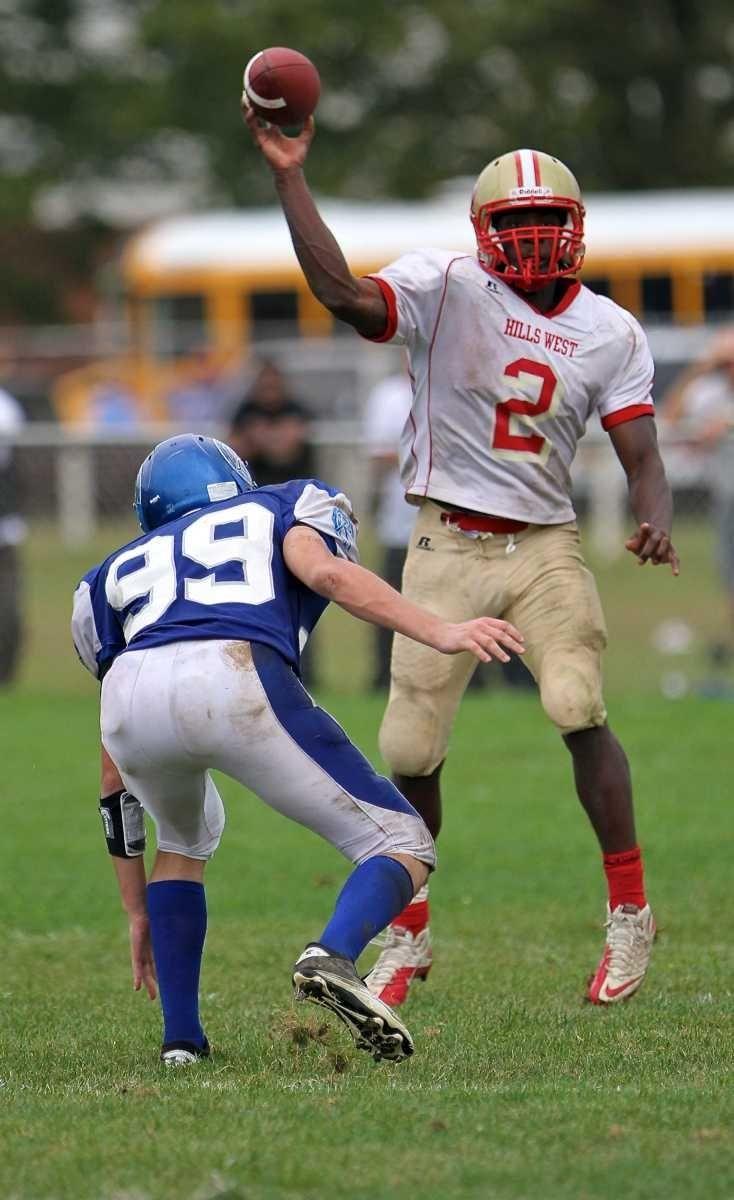 Hills West quarterback Devante McFarlene #2 gets the
