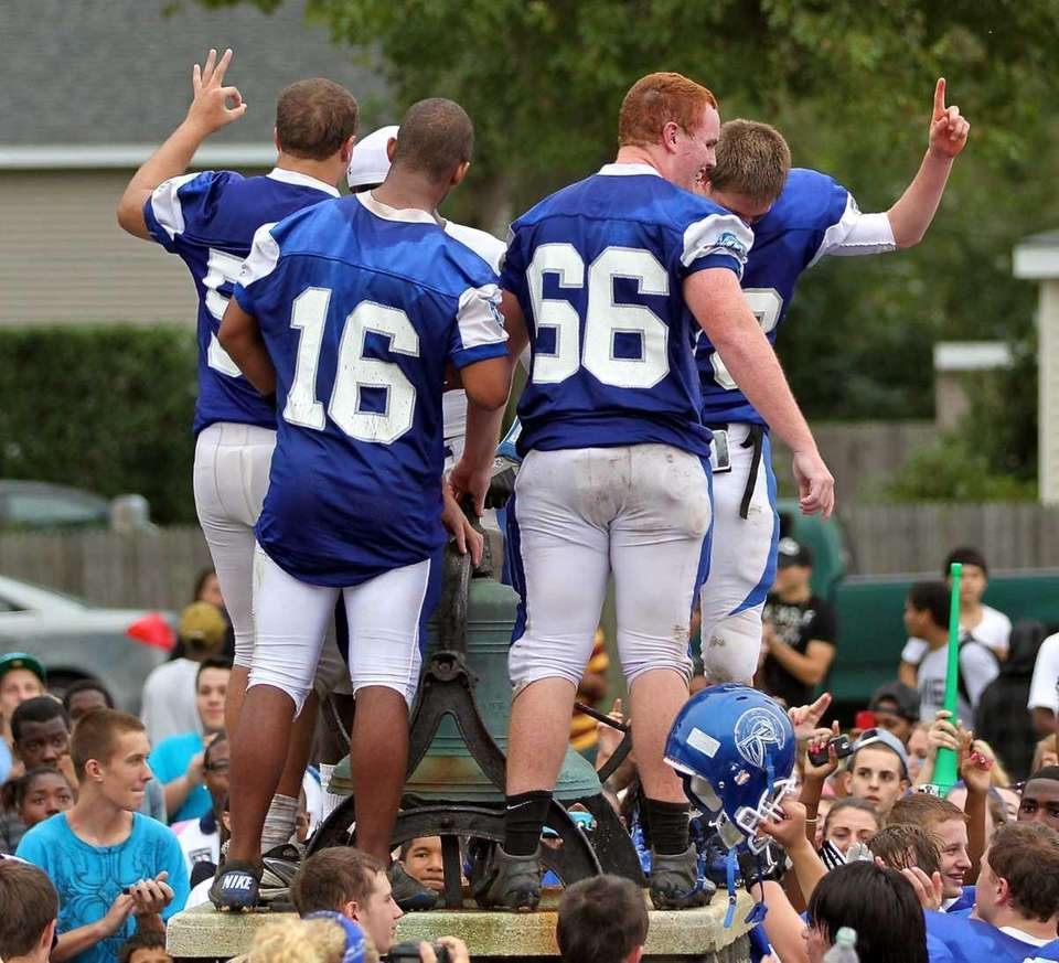 Riverhead football players ring the bell, a tradition