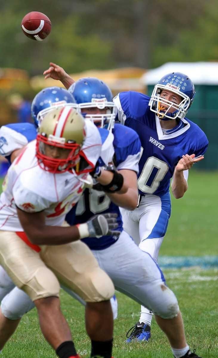 Riverhead quarterback Ryan Bitzer #10 releases the pass