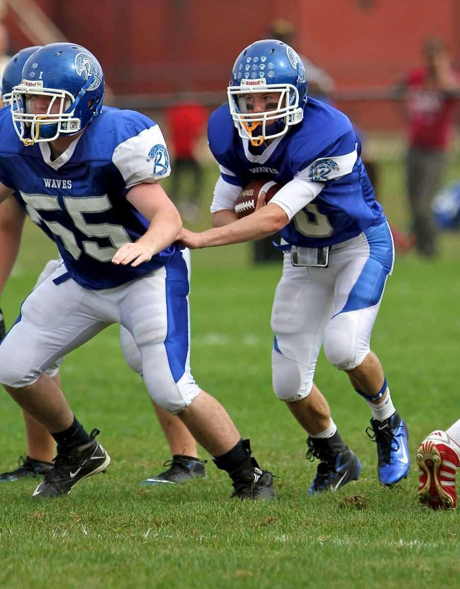 Riverhead quarterback Ryan Bitzer #10 follows the block