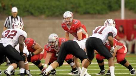 Stony Brook's Michael Coulter (10 ) looks over