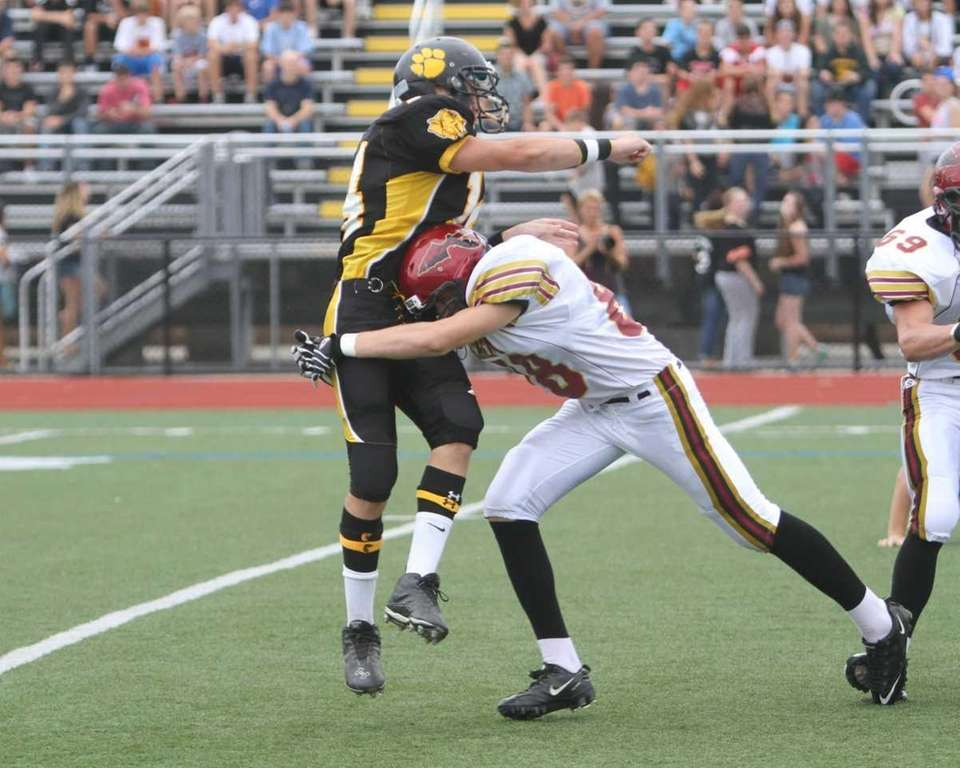 Commack quarterback #14 Ryan Heizman throws and completes