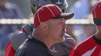 Head coach Rob Burger of Connetquot talks to