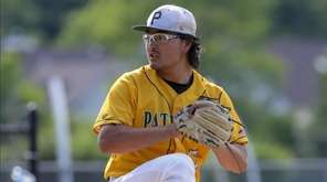 Max Nielsen of Ward Melville pitches during the