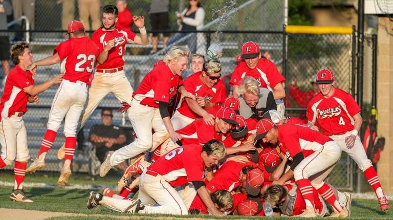 Connetquot players and coaches celebrate after defeating Ward