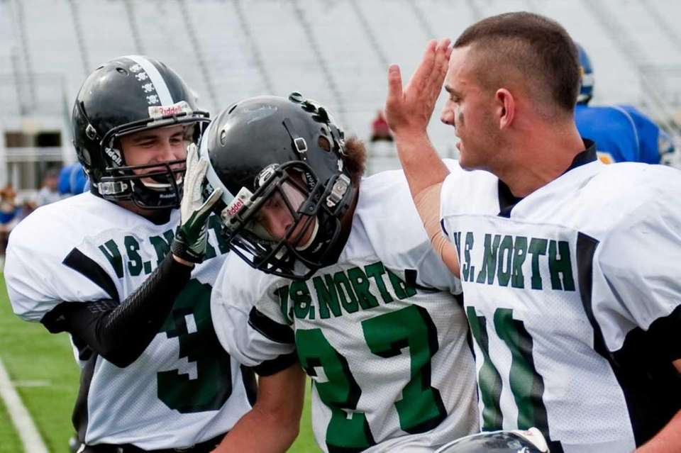 Frank Trotta, left, and Anthony Martelli, right, congratulate