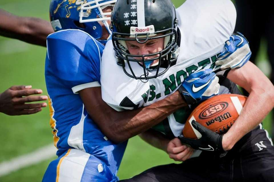 Ed Dietrich is tackled by a Roosevelt defender.