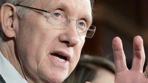 Senate Majority Leader Harry Reid gestures during a