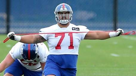 Giants guard Will Hernandez stretches during minicamp at