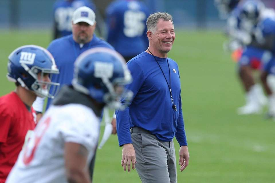 New York Giants head coach Pat Shurmur watches