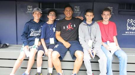 Yankees player Gleyber Torres, center, with Kidsday reports