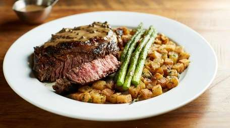 The 16 oz. grilled rib-eye comes with rosemary